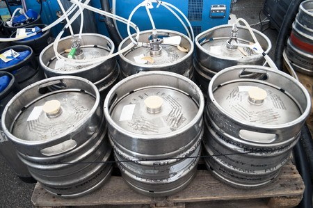 stocked: Steel indutrial barrels of beer stocked in storage