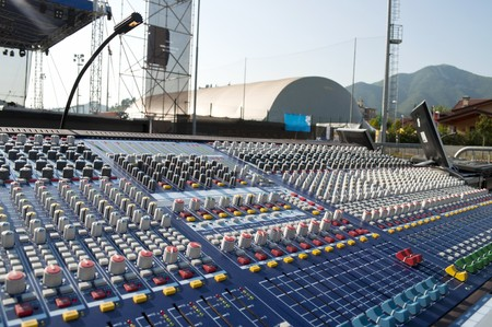 Big mixer console in a concert stage photo