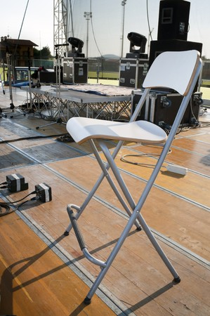 Chair on a wooden stage before a concert Stock Photo - 7434792