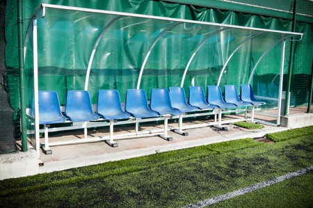 Coach and reserve benches in a soccer field Stock Photo