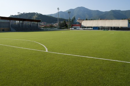 Little town soccer field stadium in plastic grass photo