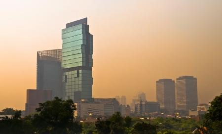 Jakarta Skyscraper skyline at dusk in orange light