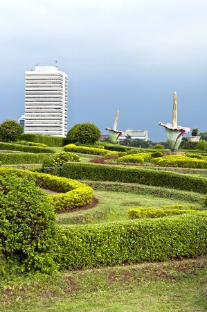 Green Jakarta park in Indonesia with flower statue photo