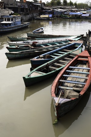 Boats in a canal of Jakarta slum, Indonesia Stock Photo