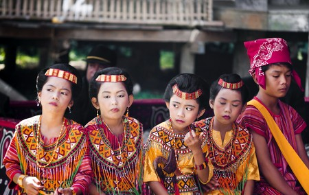 Children dressed with traditional toraja clothes during a funeral ritual in Indonesian village on 15th August 2010