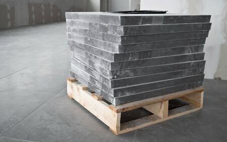 tiles floor: Under construction office with gray tiles floor posing
