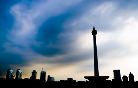 Jakarta National Monument skyline with blue cloudy sky