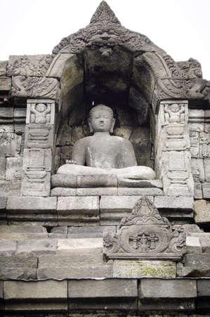 Indonesian buddha statue in Prambanan temple site photo