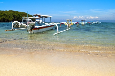 lombok: Beach with anchored traditional boats in Gili island Stock Photo