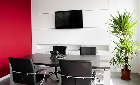 Interior office building with furniture and a red wall photo