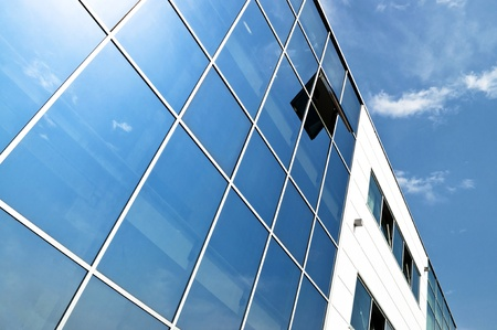 Open window in modern glass wall office building photo