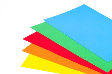 Five stacked colorful sheets on white background  photo