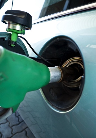 unleaded: Car supply of unleaded fuel in a petrol station