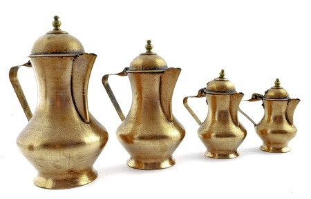 Four old fashioned style copper coffeepot isolated on white background photo