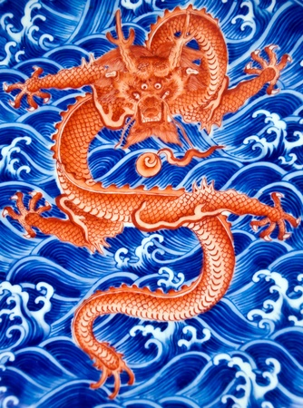 ming: Chinese red dragon on blue water, decoration of a Ming dynasty plate