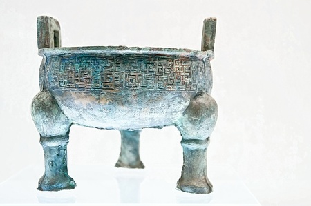 ding: Ancient bronze chinese ding with legs, cooking vessel, isolated on white background