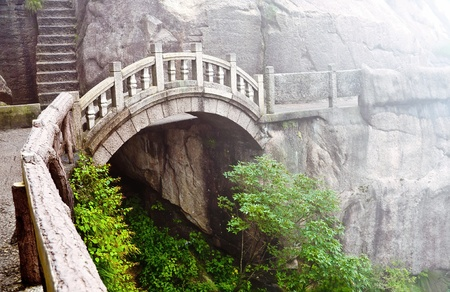 Foggy Stone bridge in Huangshan mountains, China photo