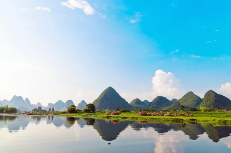 Reflection of the muntains in Li River landscape in morning light, Yangshuo near Guilin,