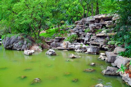 Green Japanese pond with green water Stock Photo - 10931878