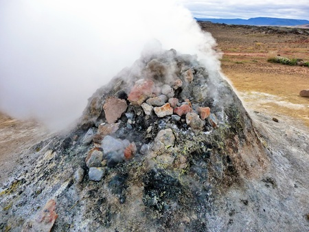 sulfide: Rock pile geothermal fumarole in iceland in summer time Stock Photo