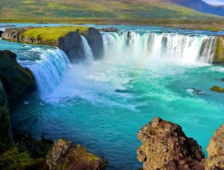 iceland: Blue wide river with waterfall in iceland landscape Stock Photo