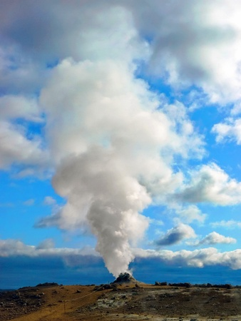 Big solfatara with steam and vapor into the sky in Iceland Stock Photo