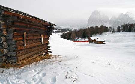 Old winter wood cottage in Dolomiti Alps, Ortisei, italy. photo