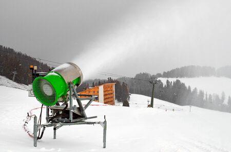 cannon gun: active artificial snow cannon on Dolomiti, Italian Alps, Ortisei