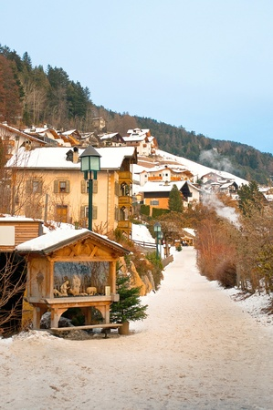 Ortisei town in winter time,  a walkway path photo