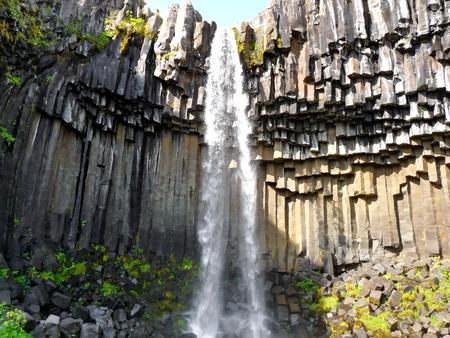 Skaftafell Iceland waterfall, cascade on basalt volcanic  rock