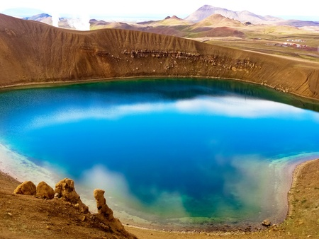 crater highlands: Blue crystal lake with clouds reflected inside