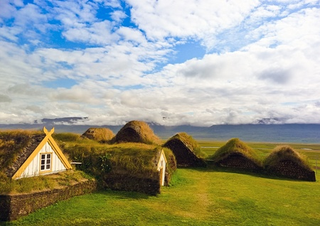 Traditional Yellow Iceland turfed roof housing with green grass Stock Photo