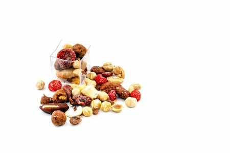 Mixed dried fruit sample on white background