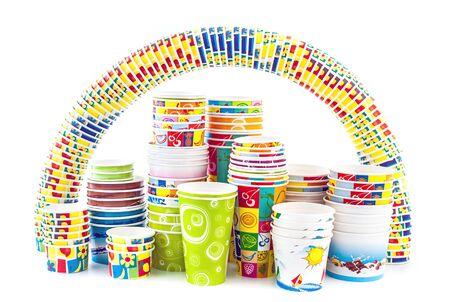 Full set of paper cups for icecream with an rainbow of cups isolated on white background photo
