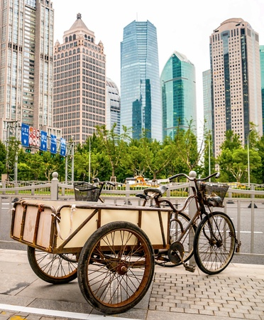 Old rusty vehicle in Jakarta business disctrict with skyscrapers in background photo