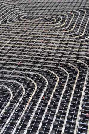 Black underfloor heating posed in a underconstruction building