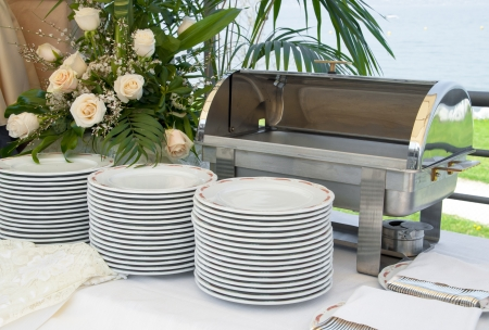 Italian Catering food warmer empty with white plate on a wedding celebration