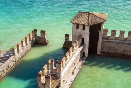 garda: Sirmione water Castle on Garda Lake  Editorial