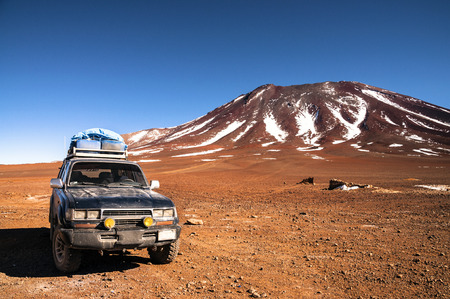 off track: 4x4 offroad vehicle in the middle of peruvian highlands with mountain in background Editorial