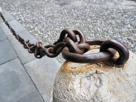 iron chain: Old anchored iron chain on the ground