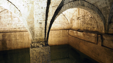Old historical underground water well in medieval environment