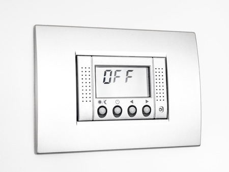 Digital thermostat isolated on white background, display Off message Stock Photo