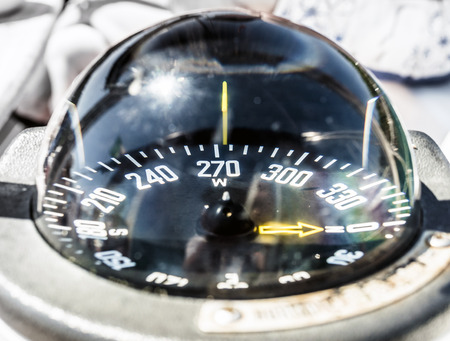 broadside: Sailing boat compass helm station with reflections Stock Photo