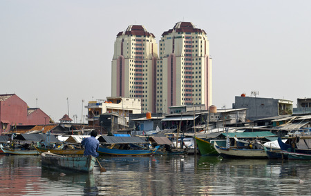 deprived: Old canal full of boats in Jakarta harbor, Indonesia