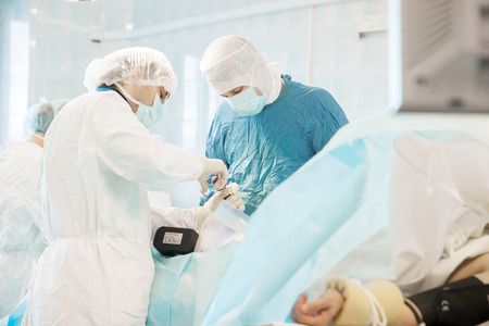 doctor surgeon: some surgeons  doing difficult operation in hospital