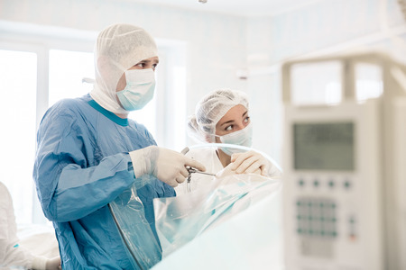 some surgeons  doing difficult operation in hospital
