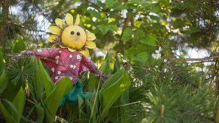 good Elf holding in the green garden photo