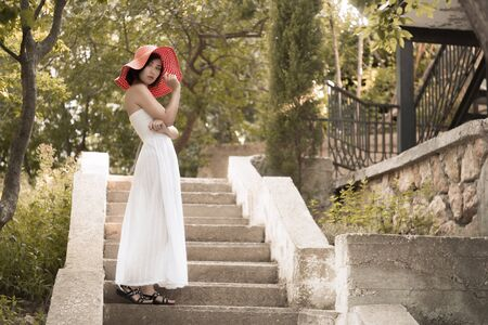 backlite: A young woman with a white dress Stock Photo