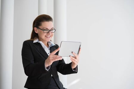 gingerish: Mature Businesswoman with Digital Tablet in Office Stock Photo