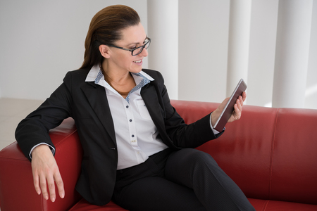 topicality: Mature Businesswoman with Digital Tablet in Office Stock Photo